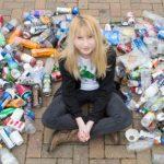 Nadia Sparkes sitting among plastic bottles.