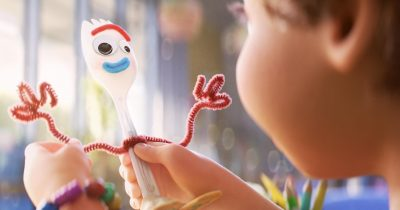 A scene of Bonnie holding up Forky, her new favorite toy made of a spork from a garbage can, in Toy Story 4.