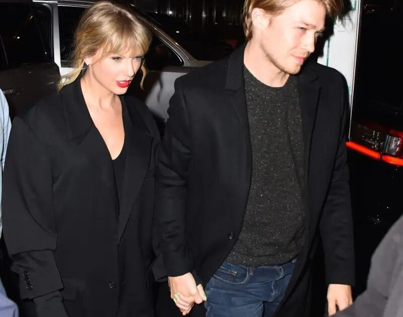 Taylor Swift waves a huge ring on her documentary and fans are convinced she's engaged.